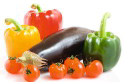 group of vegetable peppers, aubergine and tomatoes
