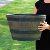 This traditional and rustic oak barrel design planter is made from durable and weather resistant plastic. The middle size of three sizes available, it