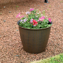 This traditional rattan effect plant pot in its brown rustic finish is made from durable and weather resistant moulded plastic. Dimensions 28. 5cm hig