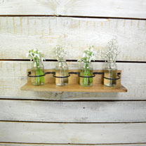 Delightful rustic flower vase set. Four glass vases rest in individual racks on a wooden base. Ideal for small posies or single flowers. Perfect for a