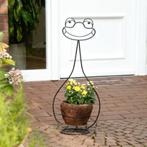 This charming frog character, carrying a rattan plant basket, is sure to delight in the garden with his cheerful expression. Height 74cm.