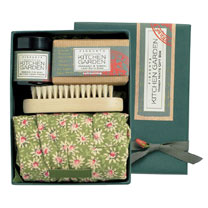 A truly 'handy gift box and a great gift for protecting hands and nails. Contains a pair of floral gardening gloves, a natural wood and bristle nail b