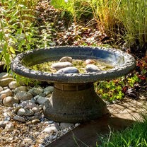 Made with Clayplas+, a lightweight durable finish which mimics an aged stone finish. Scrollwork decoration around the bird bath edge on a matt backgro