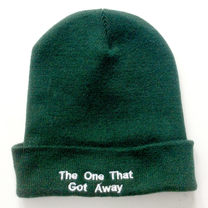 Green knitted hats with deep turnback cuff and embroidered text. One unisex size.