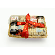 A white willow hamper containing Seville orange whisky marmalade 227g, clotted cream shortbread 200g, luxury malt whisky fudge 200g, clotted cream fud