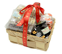 St Kew hamper containing biscuits, jam and fudge for a truly indulgent Christmas. Delivered in a handy basket to re-use. Contains: Honey oatie flips 2