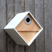 Contemporary design for urban living, a combination of ultra modern material and natural timber. The outer shell of the bird nestbox is made from Clay