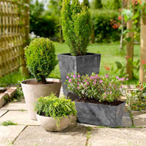 These stylish patio planters look like theyre made of slate, and its not until you touch them that youll realise theyre not! Formed from a frost-proof