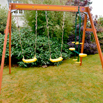 A fabulous swing set for year round play. This wooden swing set from Plum offers a 2 seat glider and double swings, which use soft feel ropes and heav