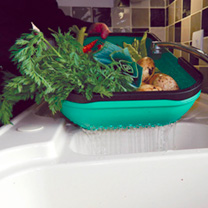 Simply collect up all your vegetables from the garden, then place the trug on the drainer, with the colander end over the sink, and wash them. Once wa